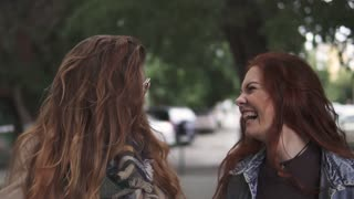 Close-up portrait of two crazy red-haired girls. Girlfriends have fun, laugh and frolic. slow motion