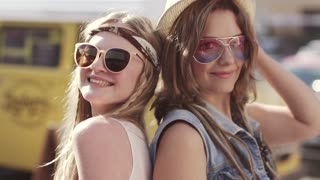 Close-up portrait of two hippy girl clothes. Young women in the style of a boho. slow motion