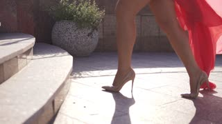 closeup of female legs in high heels. the girl climbs the stairs