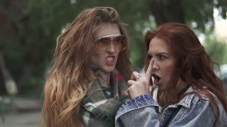 closeup portrait of two redheaded girls. girlfriends fooling around and having fun. slow motion