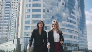 confident business women walking down the street