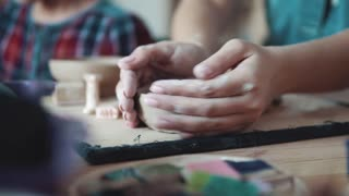 creating a plate of clay. a girl with beautiful hands sculpts an odd job at a pottery lesson