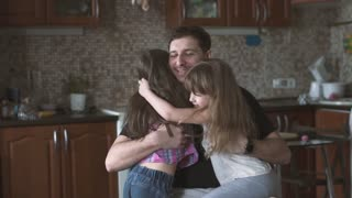 dad spends time with his favorite little daughters. a strong family slow motion