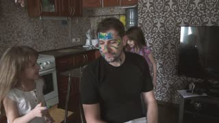 Daughters paint on daddy's face. slow motion