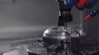 drill milling shapes out of a metal piece on a CNC machine