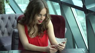 girl sends message from mobile phone and smiles