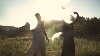 hippie girl in nirvana. Attractive young girls crazy dance at dawn. slow motion