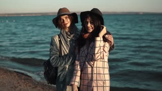 hugs and smiles of best friends. girls on the coast