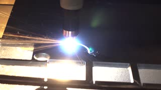 Industrial robotic laser cutter cuts metal parts with great precision. Metalworking CNC milling machine. Cutting metal modern processing technology.