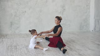 lesson of ballet mastery. a small ballerina is engaged with her teacher