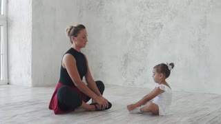 little girl for ballet classes. The choreographer teaches the ballet of a small child