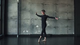 portrait of a male ballet dancer dancing classical ballet in the studio on a dark background. slow motion