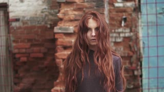 portrait of a young red-haired witch, her hair rising up And stands on end