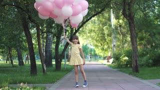 portrait of funny little girl with balloons