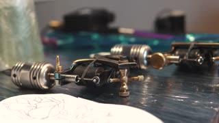 rotary tattoo machine gun. tattoo machine on the table
