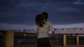 sports victory. the joy of overcoming oneself. she received training and is reaping the achievements. healthy lifestyle. Jogging night outdoor. slow motion