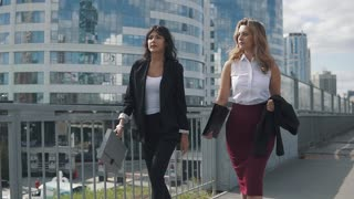 successful business women go through the business district.
