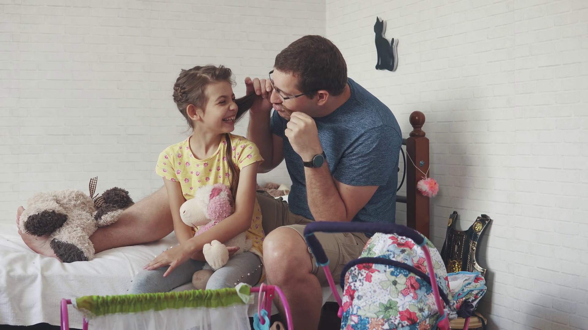 the young father spends time with his little daughter. Dad plaits pigtails to her daughter, plays with her and fools around. friendship between father and daughter. Stock Video Footage - Storyblocks