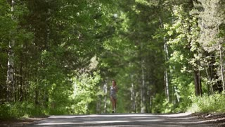 woman jogging in the morning attractive girl do sport outdoor. slow motion