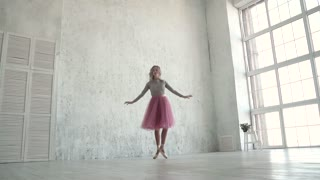 young ballet dancer dances classical ballet. A ballerina in a classic tutu and pointe dance on tiptoe. slow motion