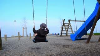 Baby girl swinging on swing