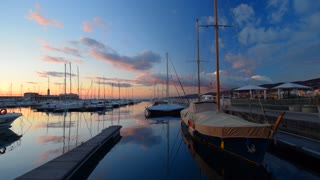 Beautiful sunset in the Harbor of Trieste, Italy. View of the sunset from the pier of Trieste. Trieste Italy