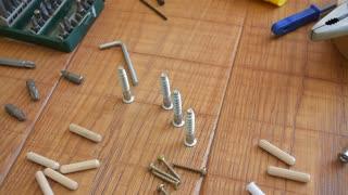 Carpenter working. Tools and screws