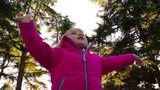 Child raised hands, outdoor