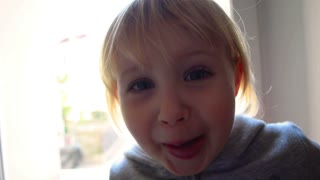 Child smiling show tongue