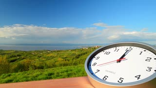 Clock fast time, time lapse, clock at background of a landscape. Time lapse clock 10 minutes.