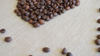 Coffee beans, coffee cup