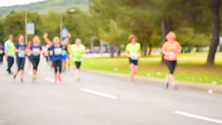Marathon runners of run along the road.