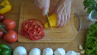 Cooking, cutting yellow pepper
