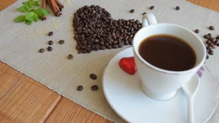 Drink coffee, coffee cup, cinnamon stick, coffee beans, heart from coffee beans.