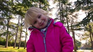 Little girl smiling slow motion