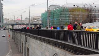 Moscow, Russia. People walk on the bridge.