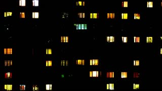 Night windows, peoples in the widows.