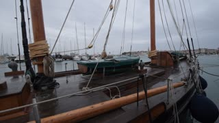 Old wooden yacht in the harbor, wooden boat