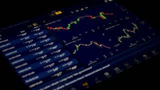 Online trading, stock market floor.