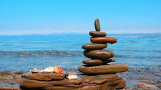 Relax background. Zen stones piramide on the background of the sea and blue sky. Adriatic coast