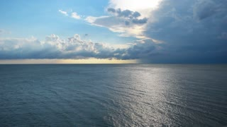 Sea, nature background. Rain clouds above sea.