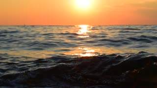 Sea wave, orange sunset, splash