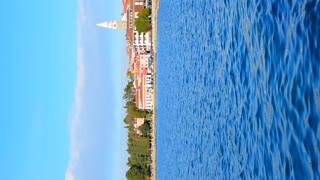 Sunny day in attraction touristic town Izola at Adriatic sea coast, Slovenia. Vertical shot
