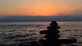 Zen stones at sea sunset background