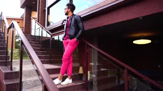 Arabic Fashion Businessman or Student Stand Smile to Camera. Young Adult Guy Demonstrate Clothing Standing Leaning on Stair Railing of Restaurant.