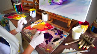 Artist Extrudes Paint From Tubes on Palette For Mixing Colors to Start Drawing Pictures in Art Studio.