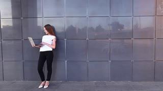 Beautiful business student woman on heels press keyboard laptop