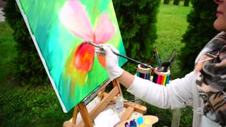 Bright Multicolored Oil Painting of Butterfly Drawn by Artist Girl in Park Outdoors.