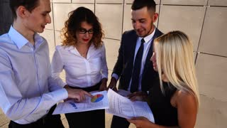 Business Team Standing Near Center Office Hold Documents Solve Problem
