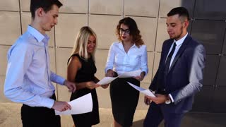 Business Team Standing Near Center Office With Documents